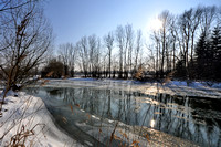 Winter Sun over the icy river Voeckla