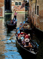 A back street with lots of light and shadow and 2 smiling gondoliers