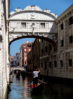 Gondolier telling the story of,...... The bridge of sighs